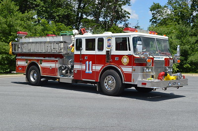 The officer side view of Reserve Engine 11 from Stephens City, a 1990 Pierce Lance.