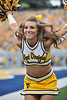 A WVU cheerleader performs during the Friends of Coal bowl between in-state rivals West Virginia University and Marshall University.WVU beat Marshall 69-34.