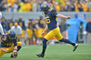 OCTOBER 19 - MORGANTOWN, WV: WVU kicker Josh Lambert (86) kicks a PAT during the Big 12 football game October 19, 2013 in Morgantown, WV.