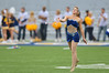 OCTOBER 19 - MORGANTOWN, WV: A feature twirler in the Pride of West Virginia marching band performs prior to the Big 12 football game October 19, 2013 in Morgantown, WV.