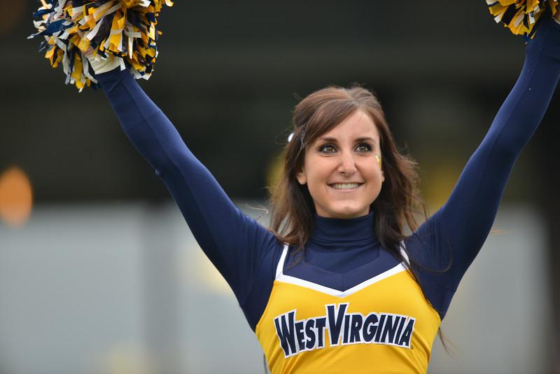 OCTOBER 19 - MORGANTOWN, WV: A WVU cheerleader performs during the Big 12 football game October 19, 2013 in Morgantown, WV.