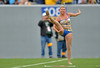OCTOBER 19 - MORGANTOWN, WV: A feature twirler in the Pride of West Virginia marching band performs at halftime of the Big 12 football game October 19, 2013 in Morgantown, WV.