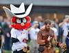 OCTOBER 19 - MORGANTOWN, WV: The Texas Tech mascot stands next to the West Virginia Mountaineer during the National anthem prior to the Big 12 football game October 19, 2013 in Morgantown, WV.