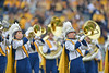 OCTOBER 19 - MORGANTOWN, WV: The brass section of the Pride of West Virginia marching band color guard performs at halftime of the Big 12 football game October 19, 2013 in Morgantown, WV.