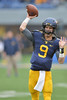 OCTOBER 19 - MORGANTOWN, WV: WVU quarterback CLint Trickett (9) warms up before the start of the second half during the Big 12 football game October 19, 2013 in Morgantown, WV.