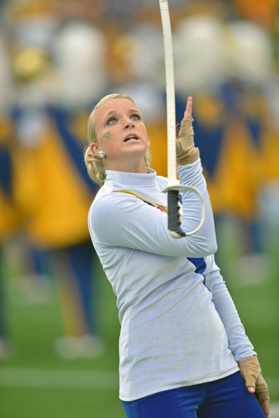 OCTOBER 19 - MORGANTOWN, WV: A member of the Pride of West Virginia marching band color guard performs at halftime of the Big 12 football game October 19, 2013 in Morgantown, WV.
