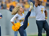 OCTOBER 19 - MORGANTOWN, WV: WVU alumni cheerleaders perform on the field prior to the Big 12 football game October 19, 2013 in Morgantown, WV.