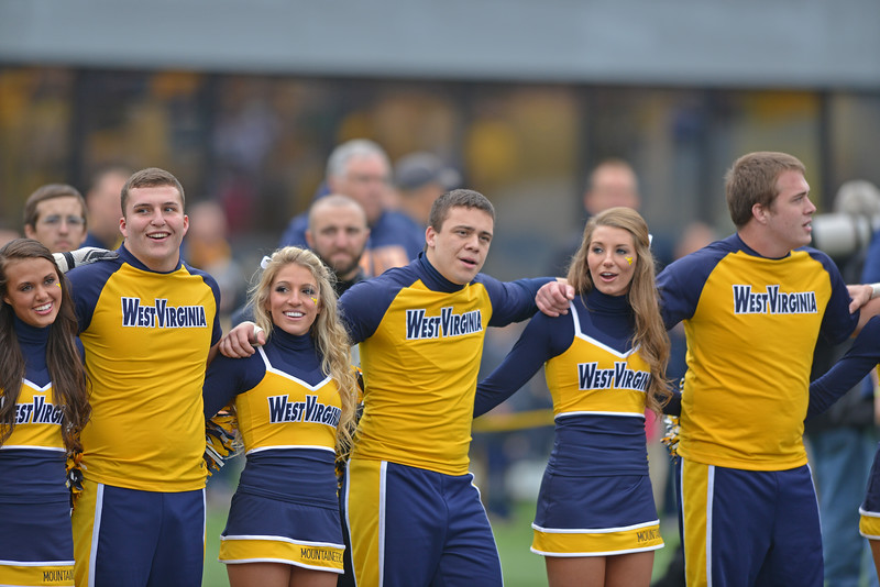 OCTOBER 19 - MORGANTOWN, WV: WVU cheerleaders sing along with the alma mater prior to the Big 12 football game October 19, 2013 in Morgantown, WV.