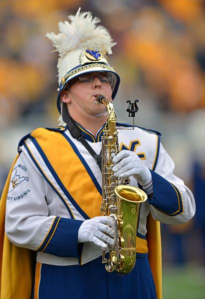 OCTOBER 19 - MORGANTOWN, WV: A sax player in the Pride of West Virginia marching band performs prior to the Big 12 football game October 19, 2013 in Morgantown, WV.