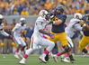 OCTOBER 19 - MORGANTOWN, WV: WVU offensive lineman Nick Kindler (79) blocks in pass protection during the Big 12 football game October 19, 2013 in Morgantown, WV.