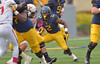 OCTOBER 19 - MORGANTOWN, WV: WVU running back Dreamius Smith (2) looks for running room behind his offensive line during the Big 12 football game October 19, 2013 in Morgantown, WV.