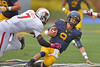 OCTOBER 19 - MORGANTOWN, WV: WVU quarterback Clint Trickett (9) braces to be hit as he slides on a scramble during the Big 12 football game October 19, 2013 in Morgantown, WV.