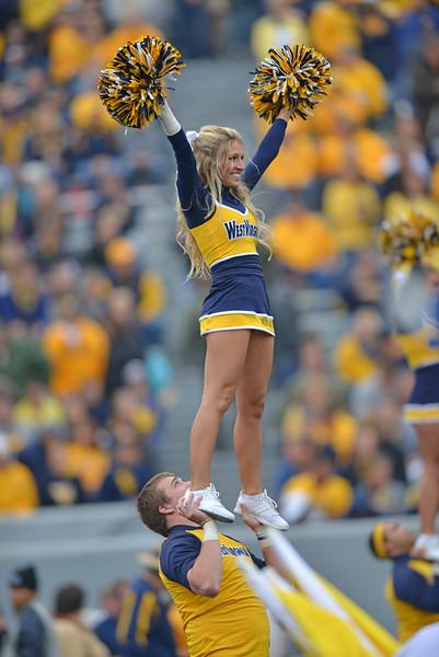 OCTOBER 19 - MORGANTOWN, WV: A pair of WVU cheerleaders perform during the Big 12 football game October 19, 2013 in Morgantown, WV.
