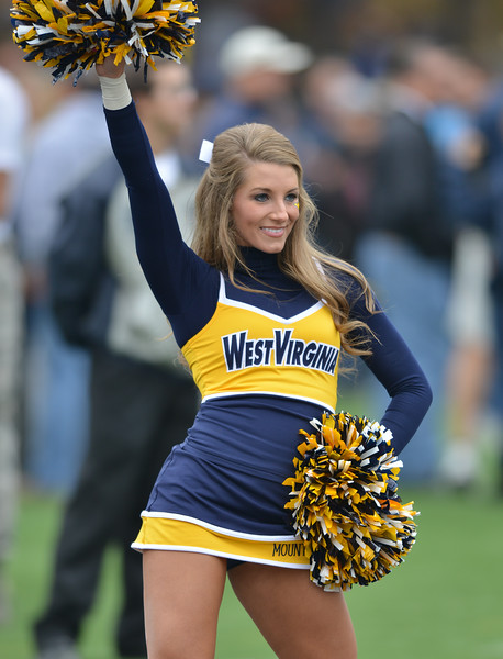 OCTOBER 19 - MORGANTOWN, WV: A WVU cheerleader performs during the Big 12 football game October 19, 2013 in Morgantown, WV.