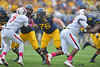 OCTOBER 19 - MORGANTOWN, WV: WVU center Pat Eger (76) looks to make a block on a run play during the Big 12 football game October 19, 2013 in Morgantown, WV.