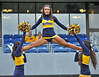 OCTOBER 19 - MORGANTOWN, WV: The WVU cheerleaders perform  prior to the Big 12 football game October 19, 2013 in Morgantown, WV.