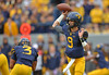 OCTOBER 19 - MORGANTOWN, WV: WVU quarterback Clint Trickett (9) throws a pass during the Big 12 football game October 19, 2013 in Morgantown, WV.