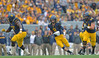 OCTOBER 19 - MORGANTOWN, WV: WVU quarterback Clint Trickett (9) runs with the ball in the open field during the Big 12 football game October 19, 2013 in Morgantown, WV.