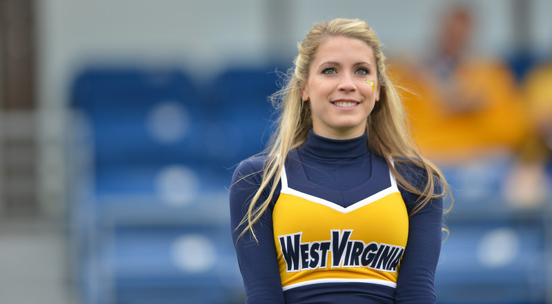 OCTOBER 19 - MORGANTOWN, WV: A WVU cheerleader performs prior to the Big 12 football game October 19, 2013 in Morgantown, WV.