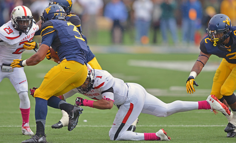 OCTOBER 19 - MORGANTOWN, WV: Texas Tech linebacker Terrance Bullitt (1) goes low for a tackle of a WVU ball carrier during the Big 12 football game October 19, 2013 in Morgantown, WV.