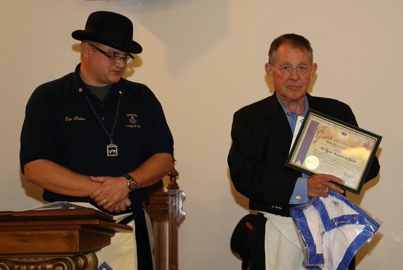 Wayne M. O'Hara, jr receives his 50yr AWG.