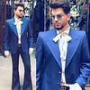 "💮 London, United Kingdom  💮 Adam Lambert's 5/30 Instagram and stories: ""London Dandy 🎩 Jacket: @marcjacobs pussy bow shirt: @gucci glasses: @gentlemonster jeans: vintage."""