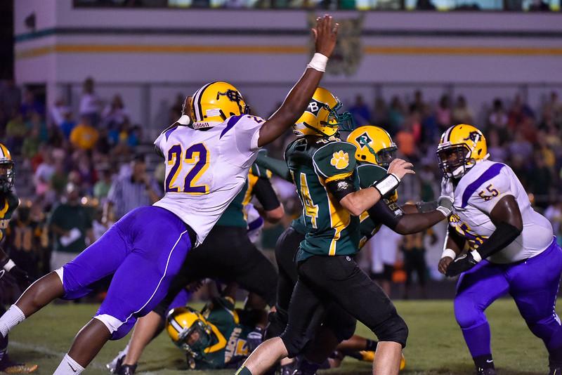 Logan Jackson (14) of Bunn Wildcats drops back to pass. Corinth Holders defeats Bunn Wildcats  61-27  Friday evening September 12, 2014 in Bunn NC (Photos by Anthony Barham / WRAL contributor.)