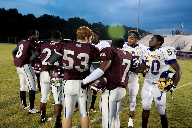 Both teams meet at the 50 yard line for tonights coin toss .Tarboro Vikings defeat Nash Central Friday Night Aug, 23 2013. (Photo By Anthony Barham)