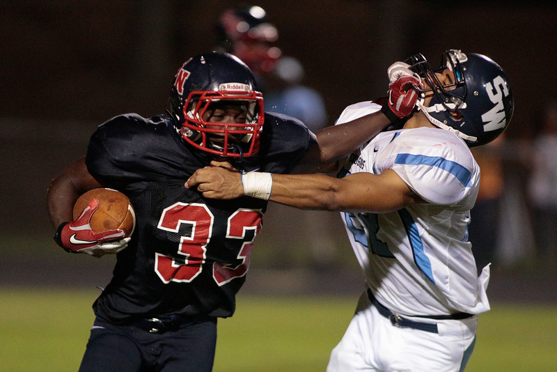 Southern Nash whitaker Clinton (33) carries the ball during tonights game.Southern Nash defeats Southwest Edgecombe Friday Night Aug, 23 2013. (Photo By Anthony Barham)
