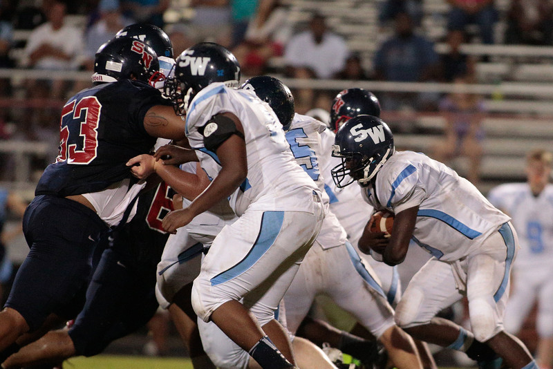 Southwest Edgecombe Quentavious Revis (6) runs up the middle during tonights game.Southern Nash defeats Southwest Edgecombe Friday Night Aug, 23 2013. (Photo By Anthony Barham)