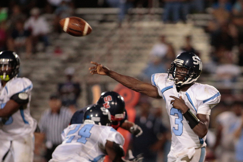 Southwest Edgecombe Tyquavious Wooten (3) drops back to pass during tonights game.Southern Nash defeats Southwest Edgecombe Friday Night Aug, 23 2013. (Photo By Anthony Barham)