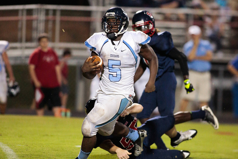 Southwest Edgecombe Devontrell Hyman (5) runs the ball up the middle during tonights game.Southern Nash defeats Southwest Edgecombe Friday Night Aug, 23 2013. (Photo By Anthony Barham)