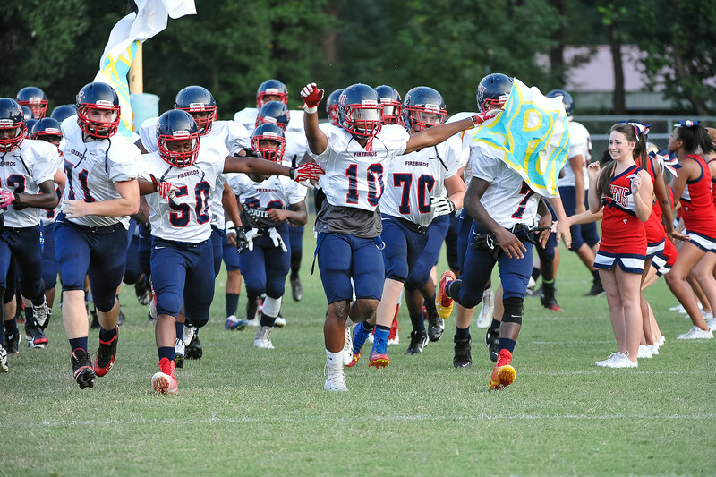 Southern Nash Demetris Perry #10 leads the firebirds on the field during tonights game .Beddingfield defeats Southern Nash 19-7 on Thursday night August 28, 2014 in Wilson NC (Photos By Anthony Barham)