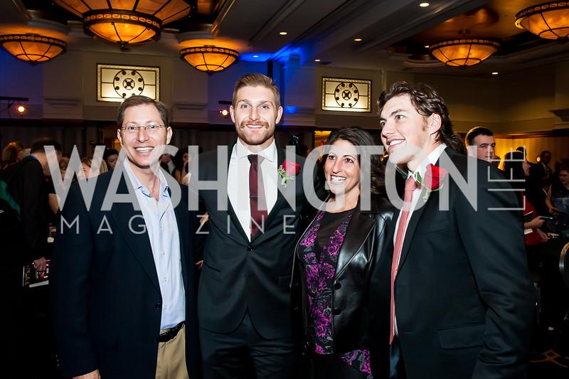 Michael Herson, Karl Alzner, Vicki Herson, TJ Oshie. Photo by Tony Powell. 2015 Capitals Casino Night. November 14, 2015