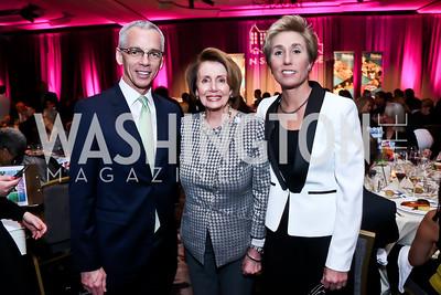 N Street Board Chair Peter Shields, Nancy Pelosi, N Street Exec. Dir. Stuart Allen. Photo by Tony Powell. 2015 N Street Village Gala. Ritz Carlton. March 24, 2015