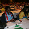 Ninth Triennial Convention | Delegates test their voting devices.