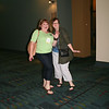 Ninth Triennial Convention | Delegates strike a pose on their way to the delegate rehearsal.