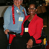 Ninth Triennial Convention | Delegates Lisette Martinez (9F) and Charlene Walker-Horton, 8F stop to pose before thedelegate breakfast.