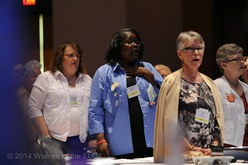 Ninth Triennial Convention | Delegates sing at the start of Plenary 2.