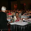 Ninth Triennial Convention | Delegates pass ballot to the page for collection.