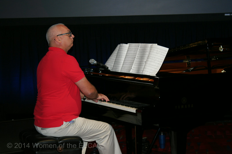 Ninth Triennial Convention | Kevin Anderson accompanies on the piano for the worship service.