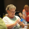 Ninth Triennial Convention | Leslie Pipen, Greensboro, NC, takes a break to check Facebook.