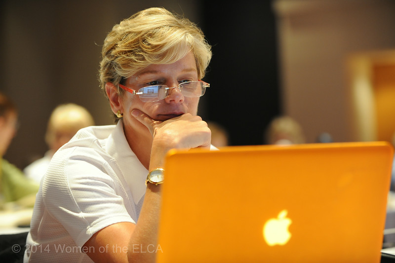 Ninth Triennial Convention | Barbara Tormondsen (7C) Ryebrook, NY., looks up some information about some of the local attractions, like the NASCAR museum, before Plenary 2 begins.
