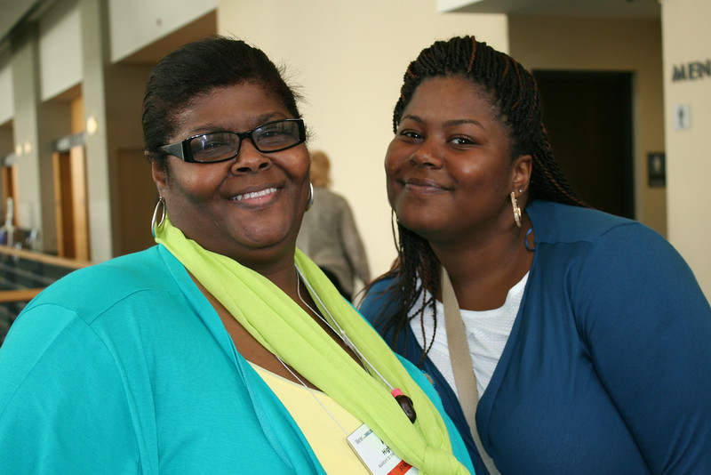 Ninth Triennial Convention | Mother-daughter team, Ann Hightower (left) and Lidia Brown take time out to pose for the camera