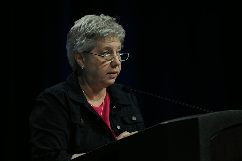 Ninth Triennial Convention | Diane Brauer offers prayer before the vote for treasurer