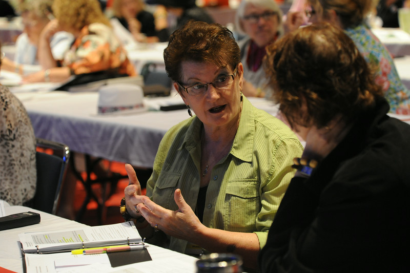 Ninth Triennial Convention | Peg Christensen, Grand Rapids, MN, Zion Lutheran discusses the reading with Joy Michalicek during the Bible study session in Plenary 3.