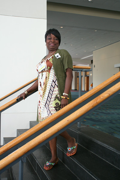 Ninth Triennial Convention | Delegate Thelma Dukuly (3G), Minneapolis, MN, stops to pose during Plenary 3