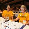 "Ninth Triennial Convention | Caitlin Vang (left), Milwaukee, WI, Ascension Lutheran and Linda Miranda, Chicago, IL, Luther Memorial rock their matching ""God's work. Our hands."" t-shirts."