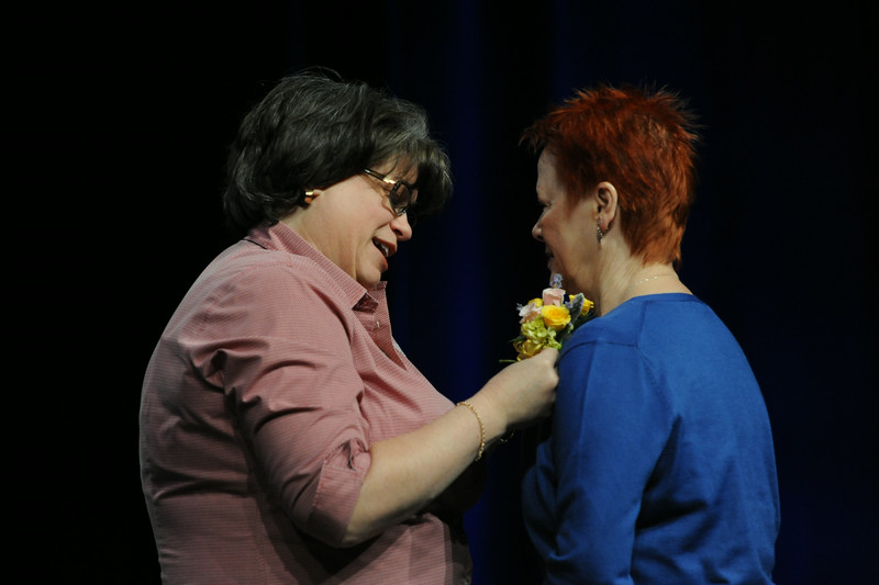 Ninth Triennial Convention | Former churchwide executive board president, Jenny Michael, pins a corsage on newly-elected president, Patti Austin in Plenary 3