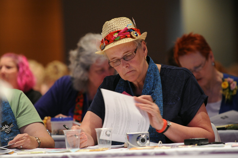 Ninth Triennial Convention   Beverly Sheridan, Decorah, IA studies the names before the vote for churchwide executive board